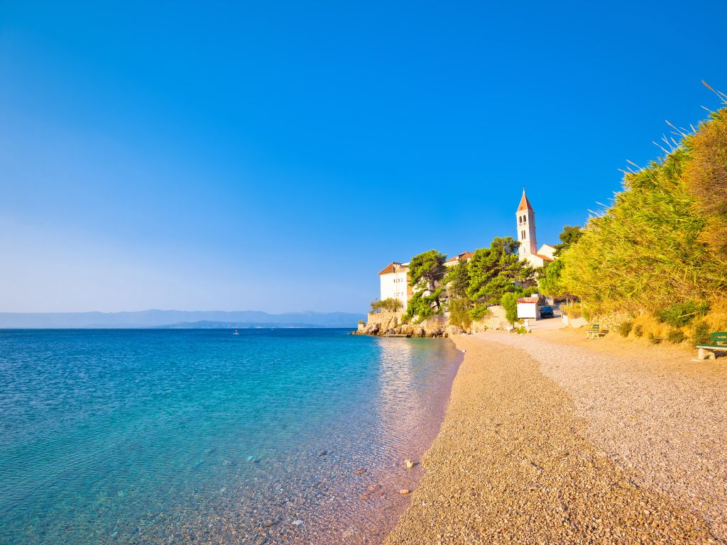 Monastery on pebble beach in Bol island of Brač, Dalmatia, Croatia