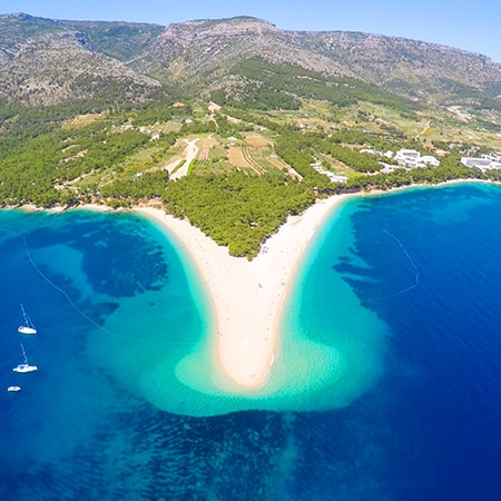 Aerial view of Zlatni Rat beach close to the town of Bol on the island of Brac, Croatia